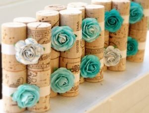 Cute white and turqoise inspired wine corks turned table pinchers.
