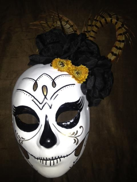 My friend painted this beautiful mask and decorated it with flowers and feathers. So cool!
