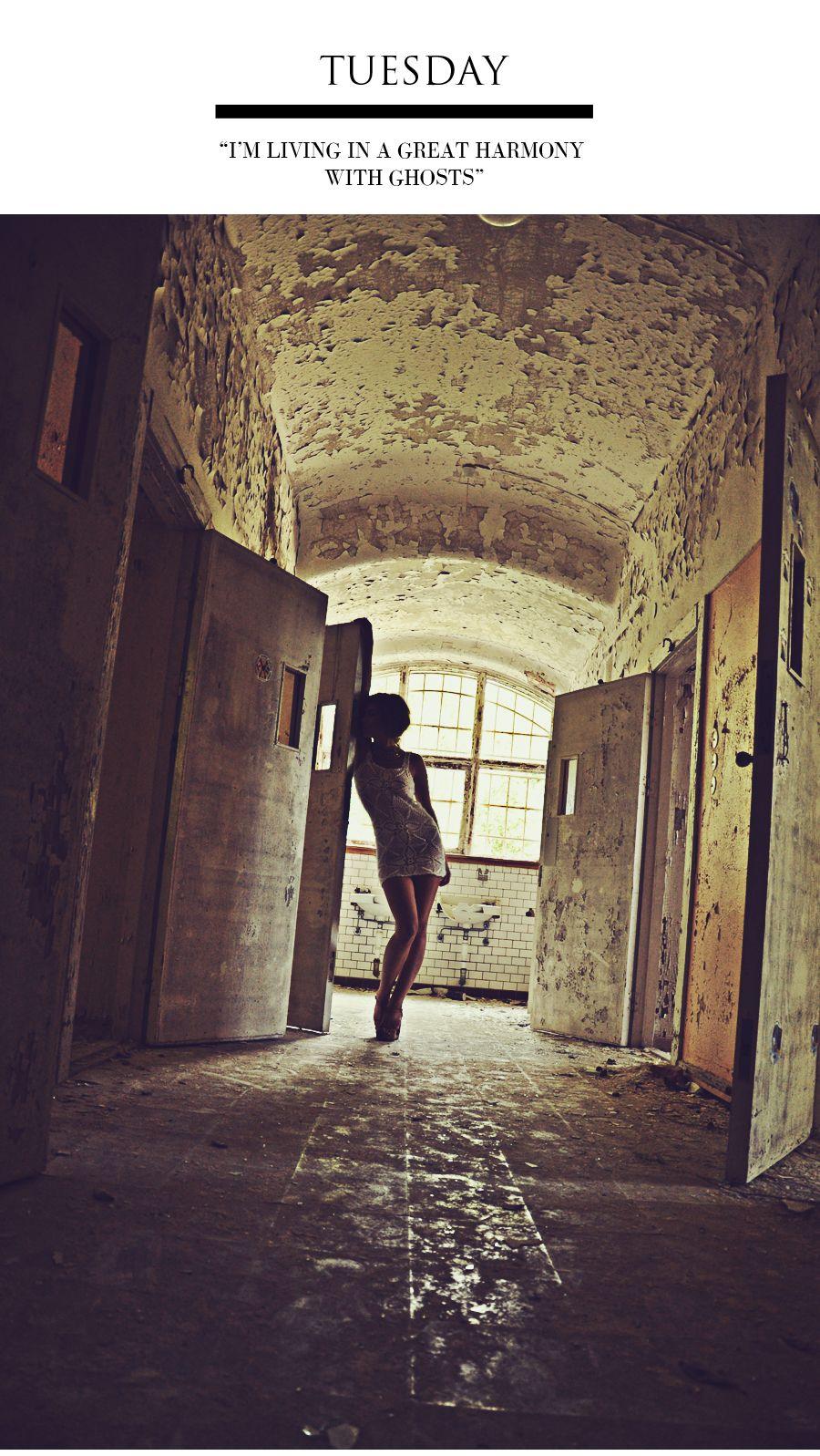 Abandoned warehouse / peeling paint / window / doors / woman / photoshoot