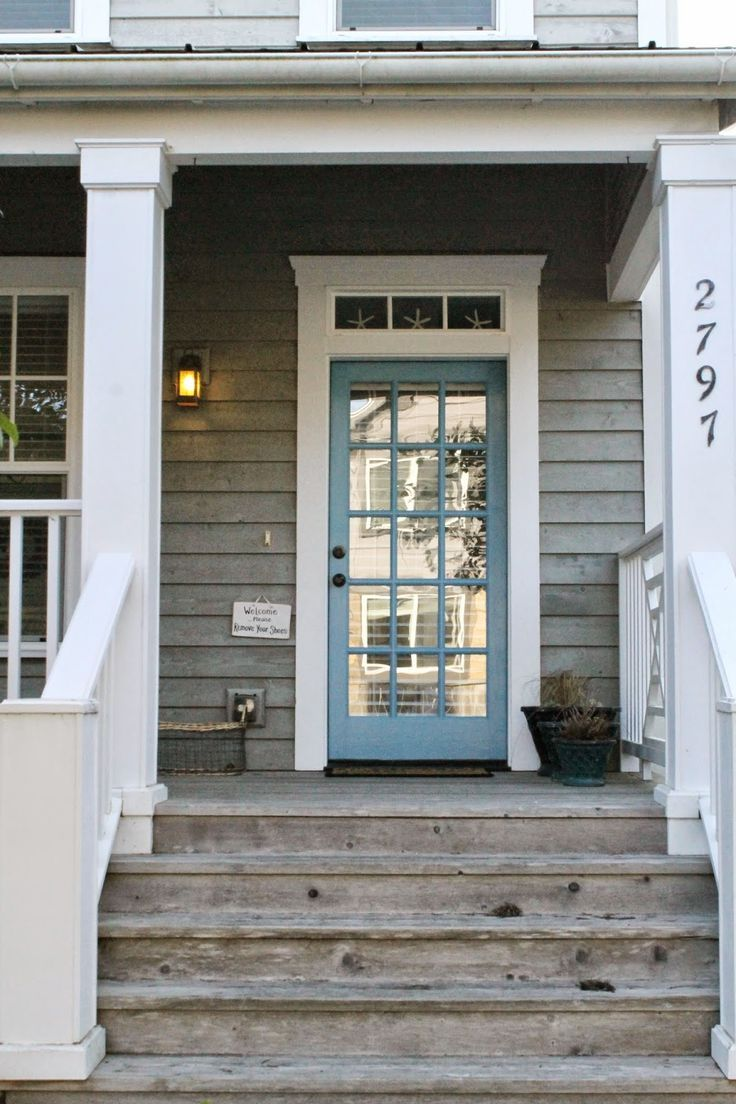 Great porch love the worn wood white trim and blue door for White back door