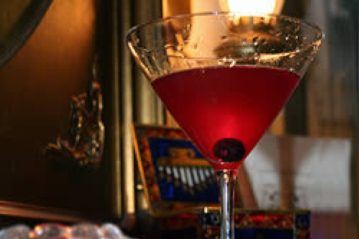 Blueberry Vodka Martinni  1 Vodka  1 Cup raspberry liqueur  1 lime juice  Blueberries (rinsed )