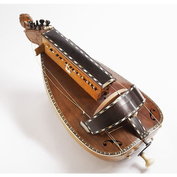 this is the hurdy gurdy it is a string instrument that makes sound by a crank turning and. Black Bedroom Furniture Sets. Home Design Ideas