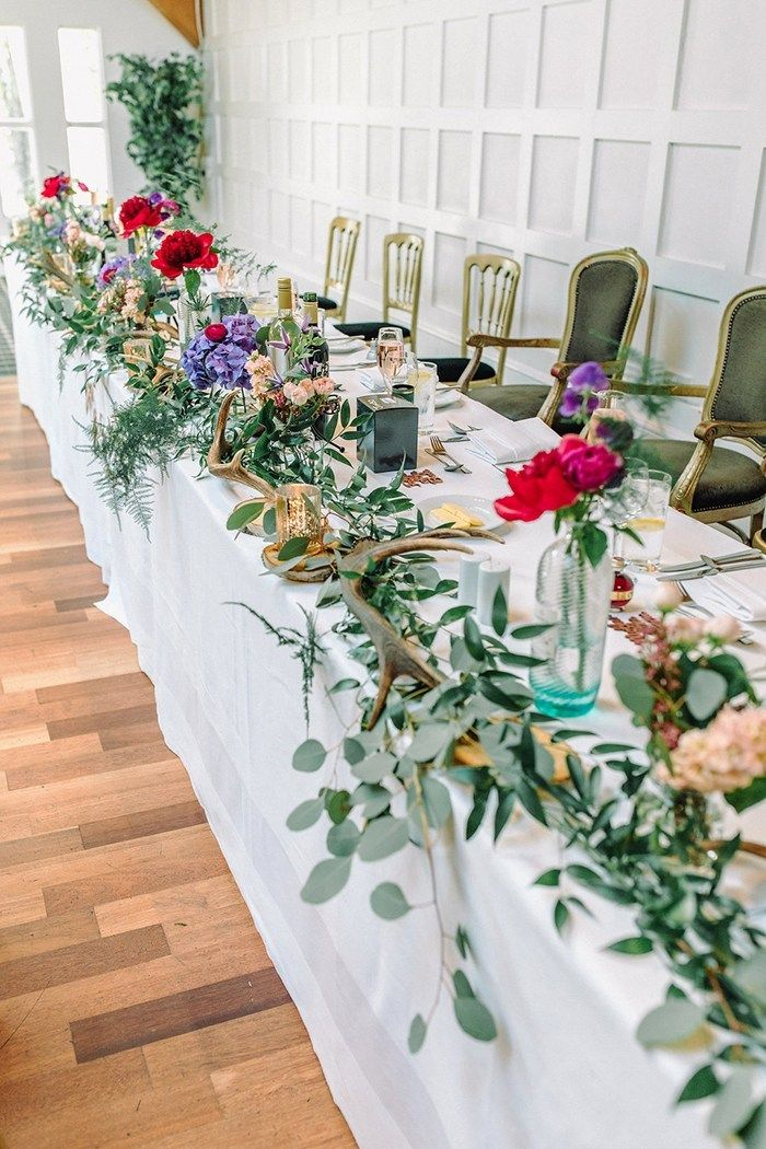 Floral garland table decoration Cool waterside wedding with amazing flowers at The Cruin, Loch Lomond - Scottish Wedding Directory #lochlomond