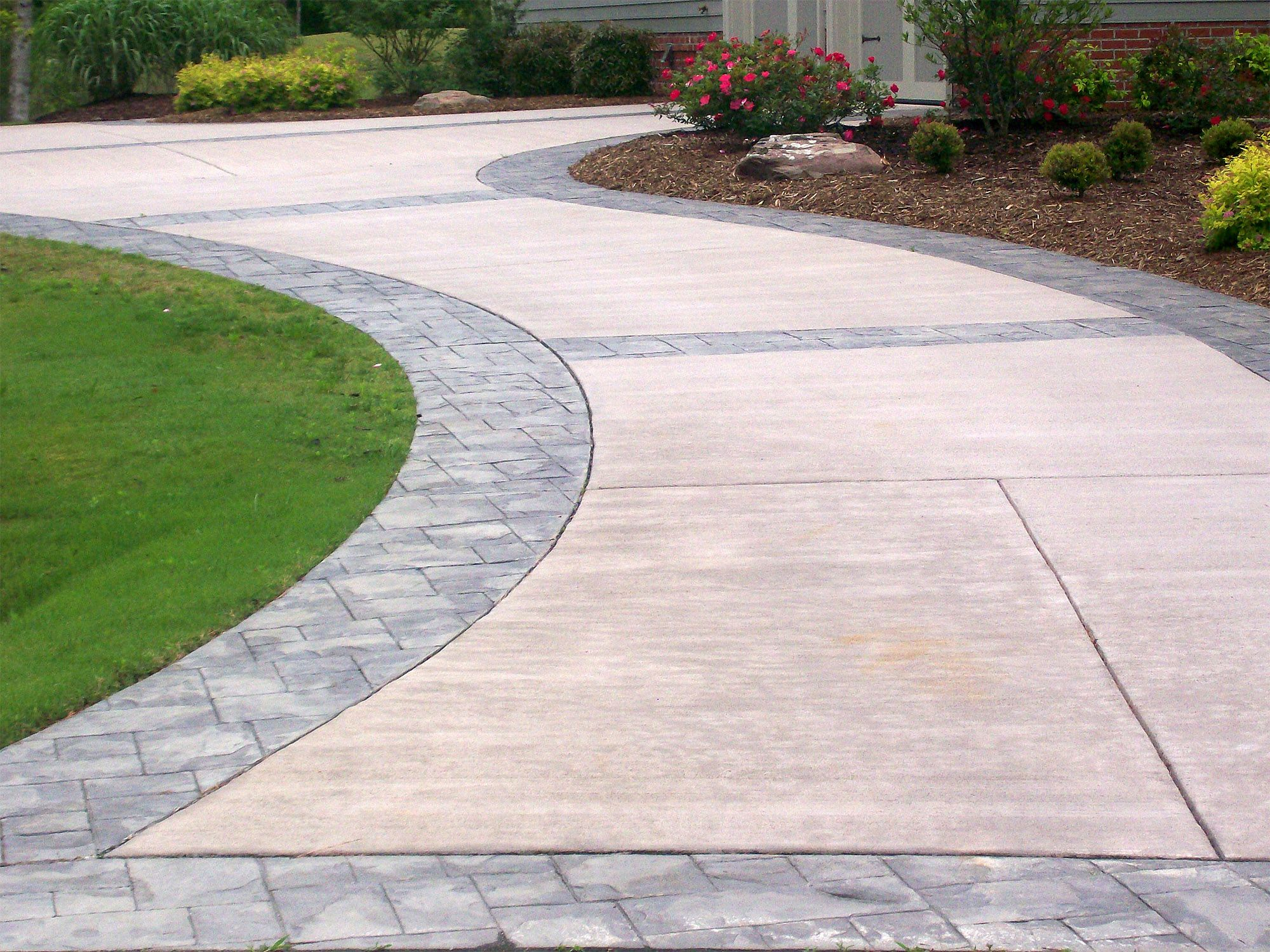 Brand New Refinished Concrete Driveway With Decorative