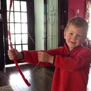 Parker made his own bow from a stick, a rubber band and duct tape!