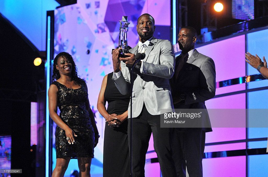 Honoree Dwyane Wade accepts award onstage during the 2013 BET Awards at Nokia Theatre L.A. Live on June 30, 2013 in Los Angeles, California.