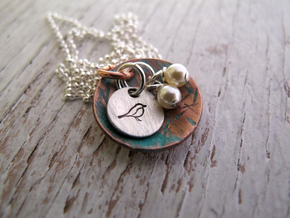"Bird Nest Necklace, Nest Egg Necklace, Hand Stamped Bird Nest, Mama Bird, Mother's Day Jewelry Hand Stamped and Made to Order for You! This copper disc is domed and hand stamped like a bird's ""nest"" with a blue patina for that aged rustic look. I add the number of pearls to represent the mama bird's ""babies"". Includes a small sterling disc with a bird to represent mama. Hung from a sterling silver rolo chain. Copper disc measures 3/4"" Silver disc measures 3/8"""