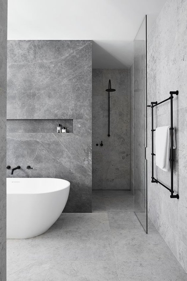 10 Stunning Stone Tile Bathroom Designs That Made Our Editors Do A Double Take Hunker Bathroom Tile Designs Stone Tile Bathroom Bathroom Inspiration