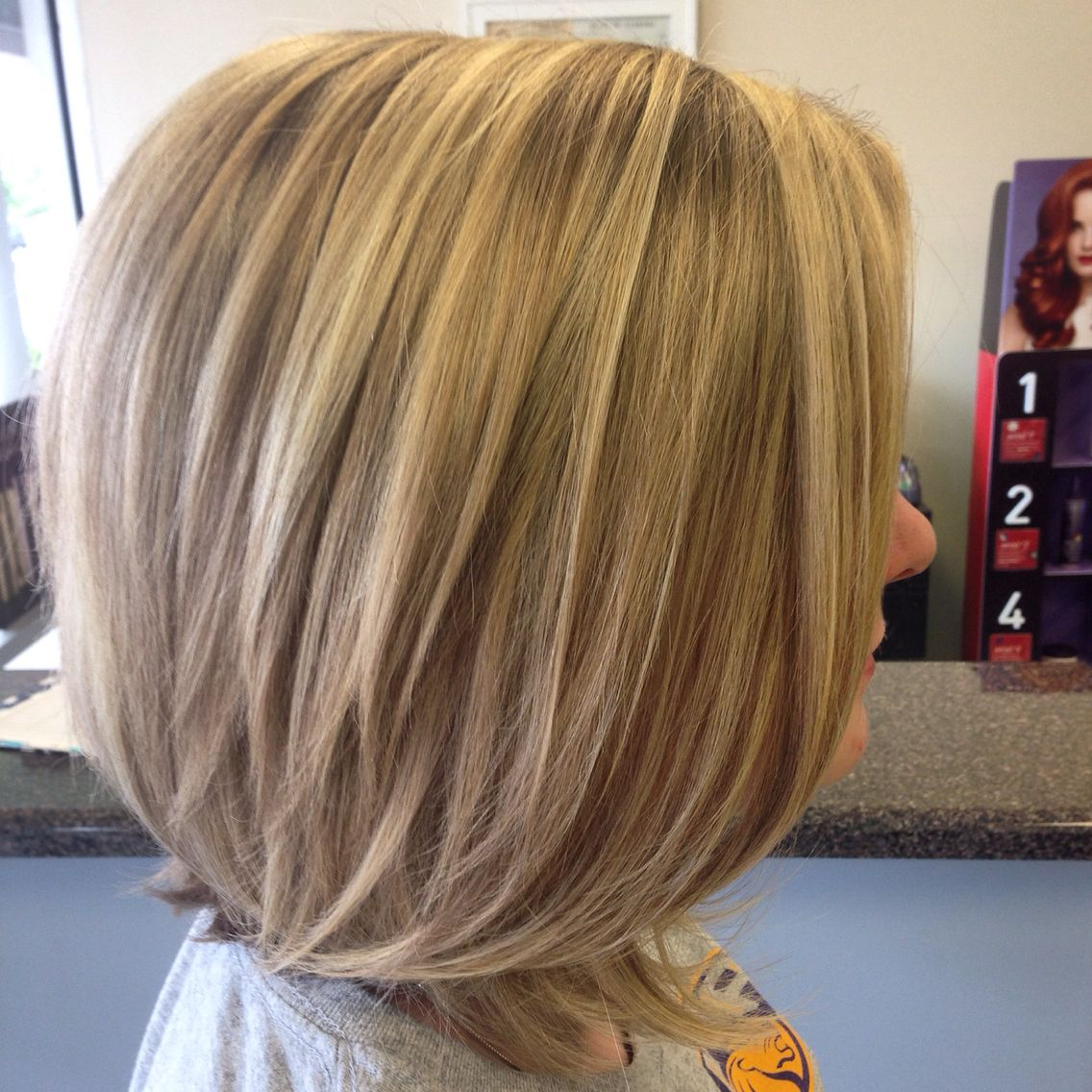 Dark blonde hair with highlights. Long bob haircut
