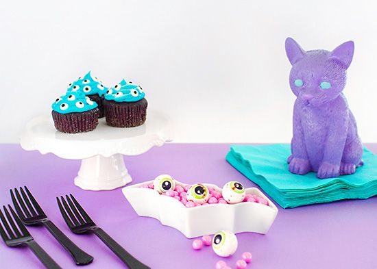Pastel goth party decor lavender cat and eyeball cupcakes https