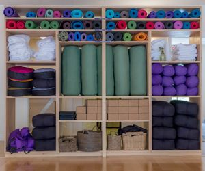 large equipment shelf with yoga mats straps blocks