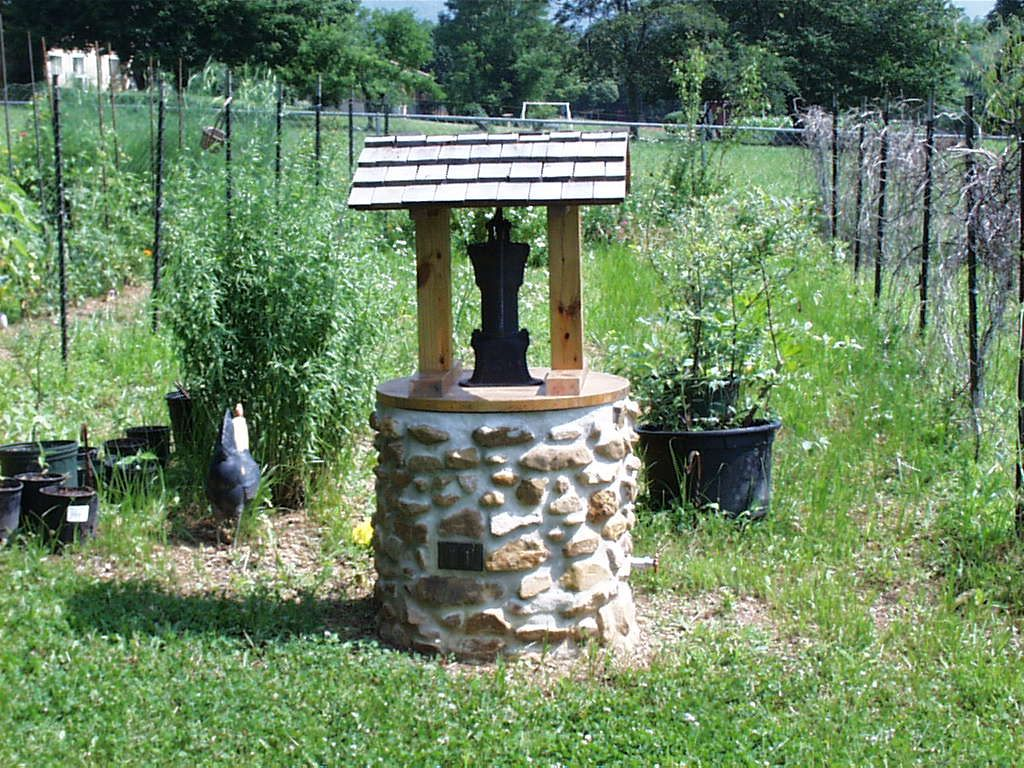 Garden designs with bridges and wishing wells landscaping ideas - Stone Well Covering Water Faucet