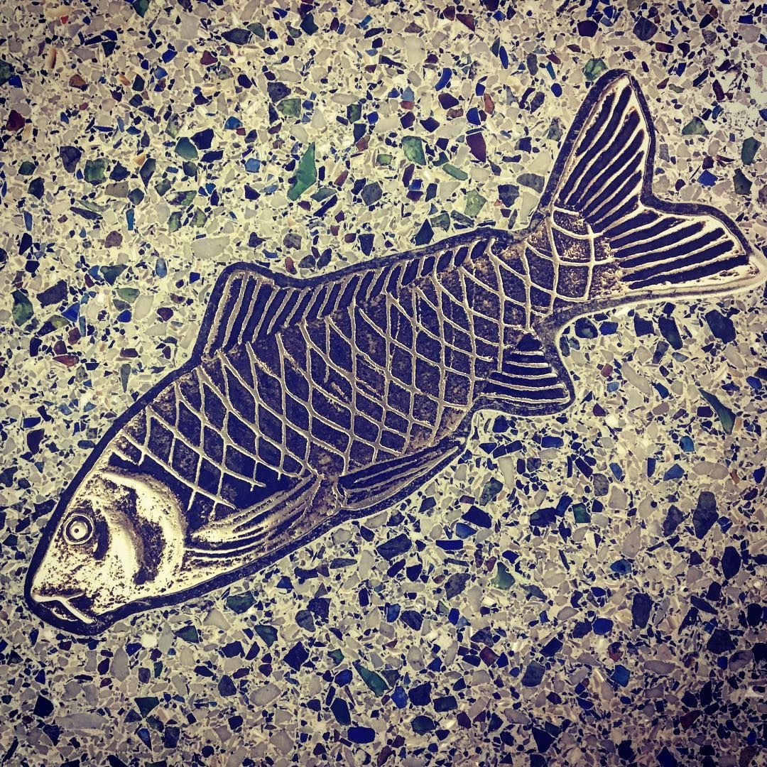Metal Fish Inlaid In Terrazzo Floor At Seattle Tacoma