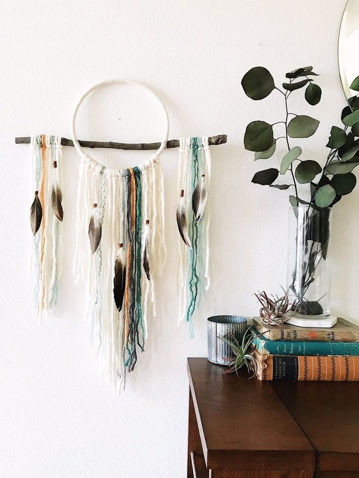 Designed with airy texture, a gorgeous and contemporary color palette, and carefully selected natural elements, this unique dream catcher wall hanging will bring modern boho style and a breath of fresh air to your home! And now available in a smaller, more accessible size, this statement piece is perfect as a gift for friends or for yourself! #dreamcatcher #bohochic #homedecor #bohobedroom #wallhanging boho chic bedroom // boho bedroom ideas // modern boho living room // boho living room