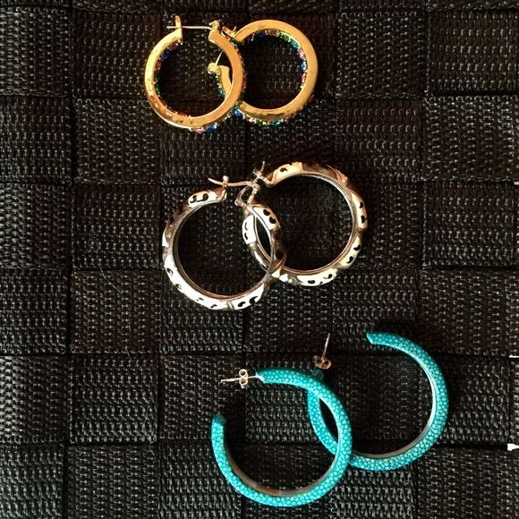Hoop Earrings Lot of 3 sets of Fashion hoop earrings.                        Top set: gold with multi colored crystals                   Middle set: silver with animal style print                  Bottom set: cracked turquoise acrylic                       Never worn Jewelry Earrings