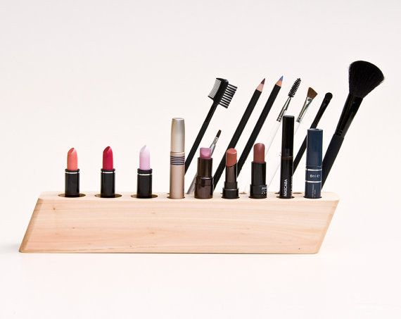 A geometric makeup organizer made of wood.