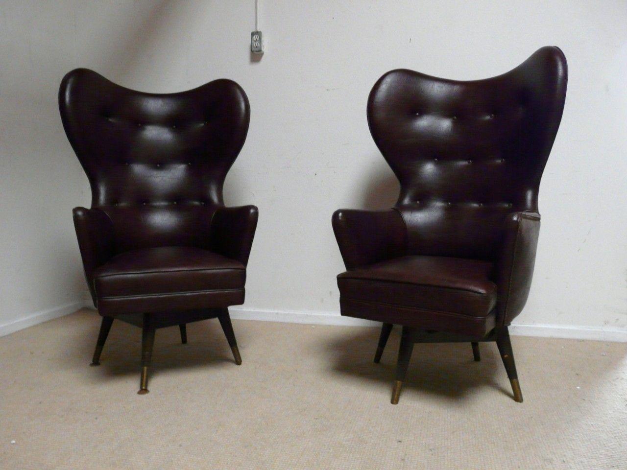 vintage egg/wing shape swivel chairs. awesome shape