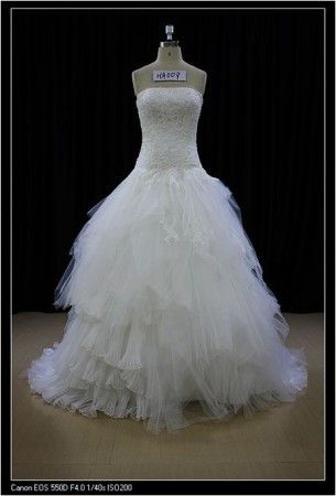 Here is a dropped waist wedding dress with strapless neckline.  The organza ball gown skirt is random.  The strapless bodice has beaded lace details.  Get this designer wedding dress made to order with any changes and in your exact body shape. pricing and details on custom #weddingdresses that are affordable can be obtained at www.dariuscordell.com