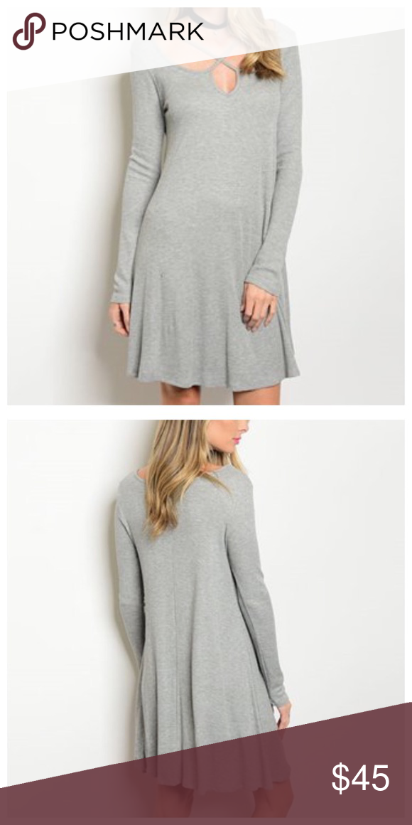 """🆕Strappy Crisscross Neckline Dress Sweet gray dress with crisscross detail at neckline. Material is textured like thermal material. S (36"""" bust) M (38"""" bust) L (40"""" bust). 35"""" in length. 95% Rayon, 5% Spandex & is very stretchy. So cute! Dresses"""
