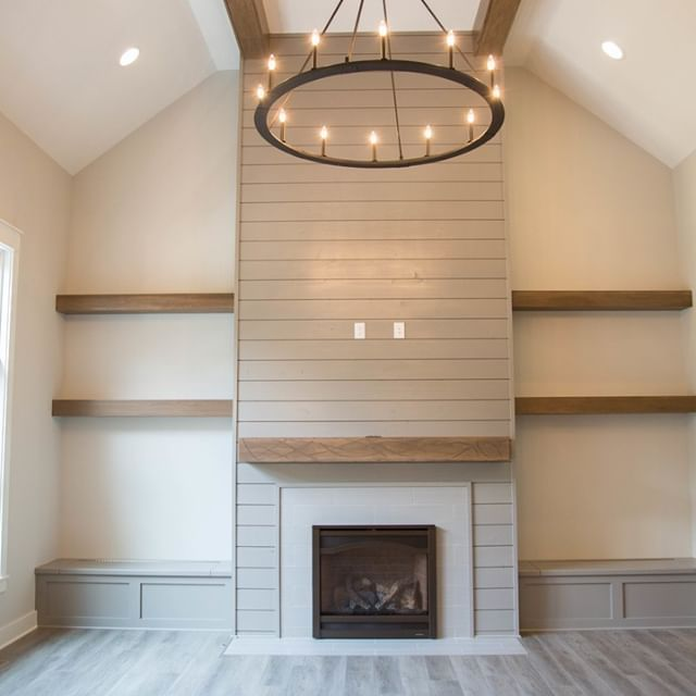 Gray shiplap fireplace - stunning floor to ceiling! Combined with a gorgeous wood mantle + built-ins make the perfect living room setting!  #rustic #shiplap #shiplapwall #fireplace #floortoceilingfireplace #builtins #livingroom #livingroominspo #dukehomes #indyhomes #indyhomebuilder #newbuild #indianapoliscustombuild #housegoals #homegoals #livingroomgoals #interiordesign #homedesign