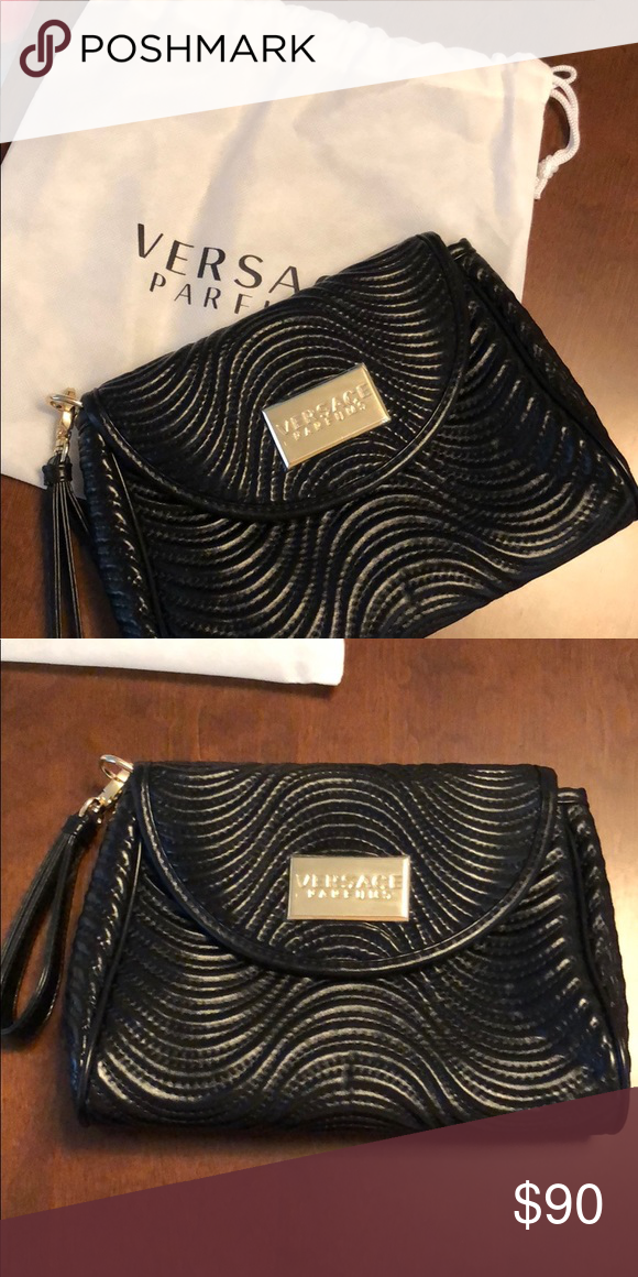 c3dd95c9e90 Brand new Versace parfums black clutch Black clutch never been worn!!!! Versace  Bags Clutches & Wristlets