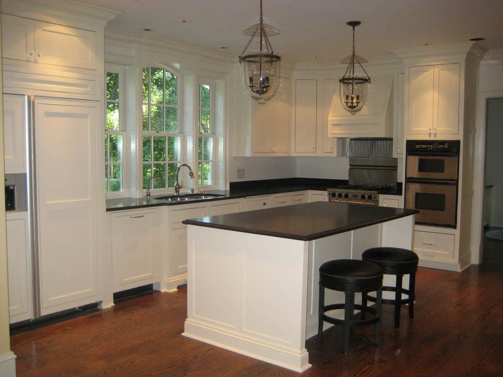white cabinets with chunky crown moulding and huge window over ...