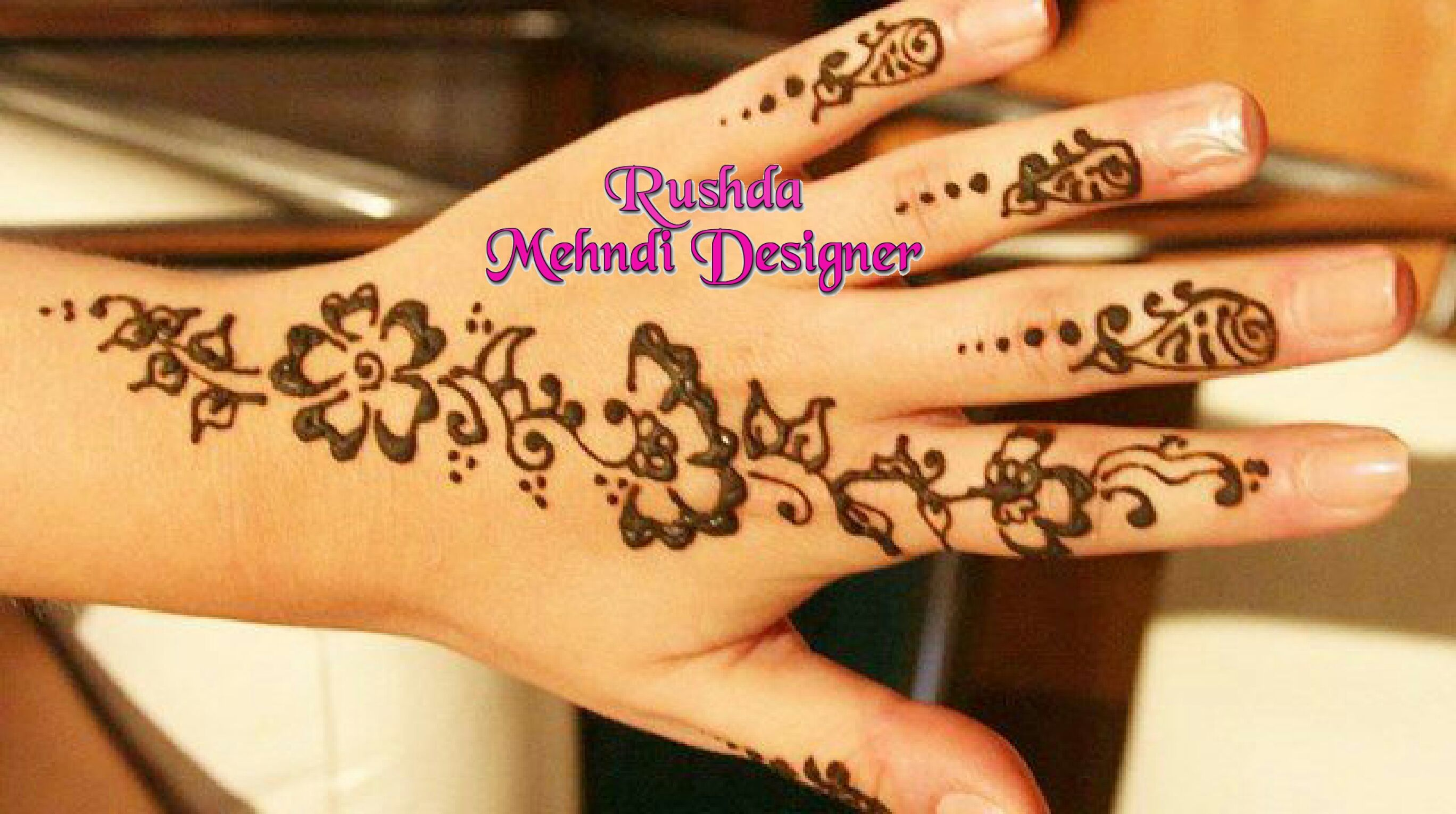 to RUSHDA MEHNDI DESIGNER by Farhat a Professional
