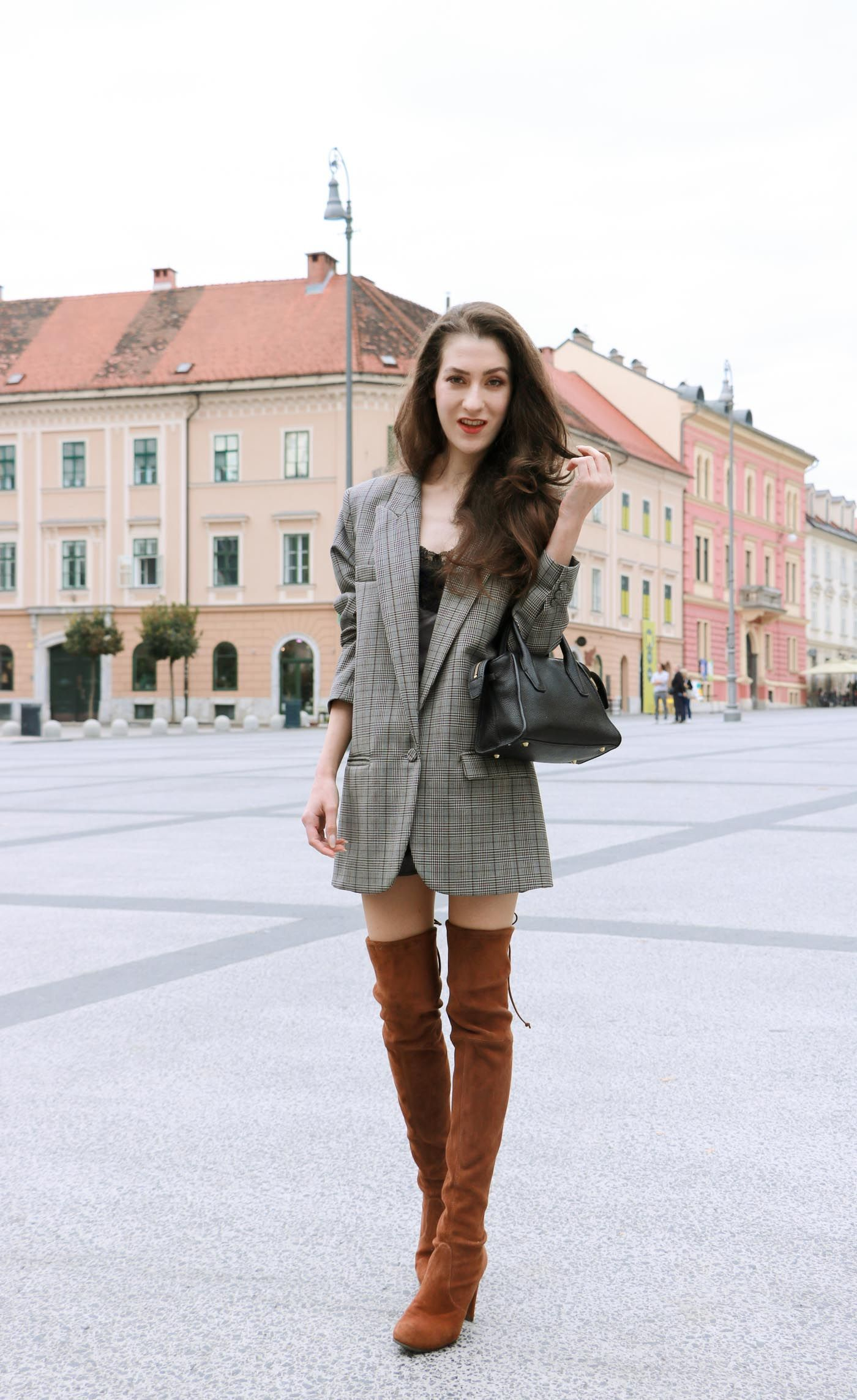 e4c8847fa93 Fashion Blogger Veronika Lipar of Brunette from Wall wearing brown Stuart  Weitzman highland boots
