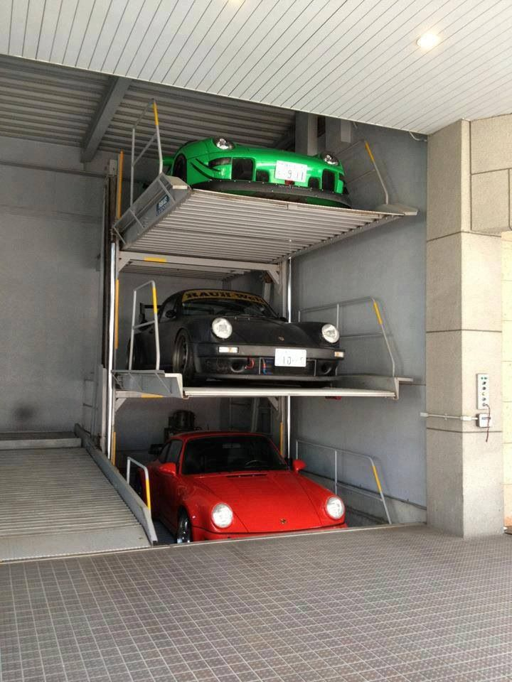 porsche garage storage if i had 3 porsches and a stacking system like this they sure as hell. Black Bedroom Furniture Sets. Home Design Ideas
