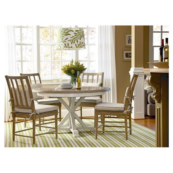 Anchor The Dining Room In Timeless Style With This Essential Table Showcasing An Extendable Leaf