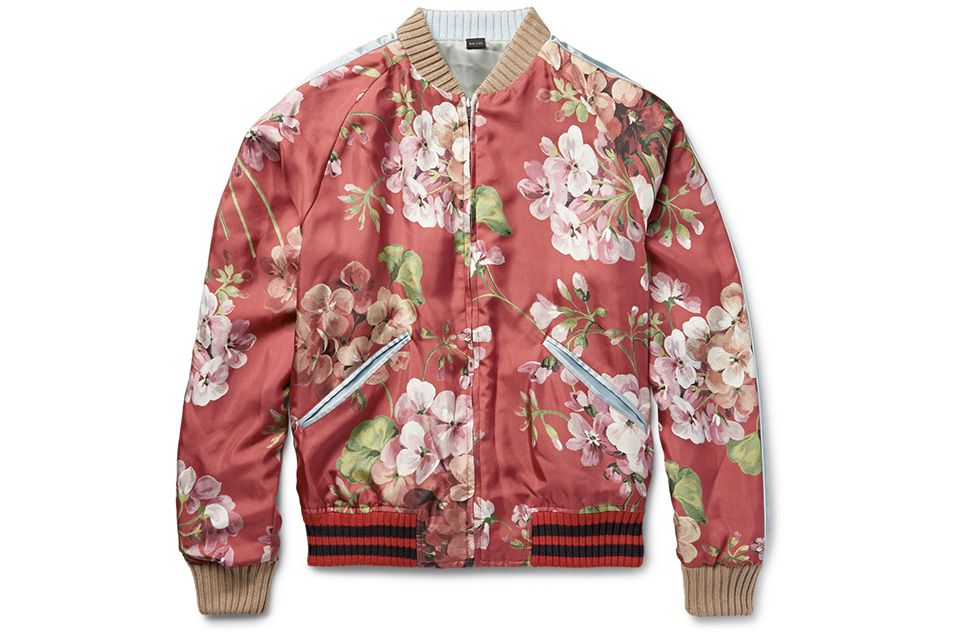 ec35e55b3 Gucci keep to their elaborate floral graphics this season with the release  of an eye-catching silk bomber jacket.