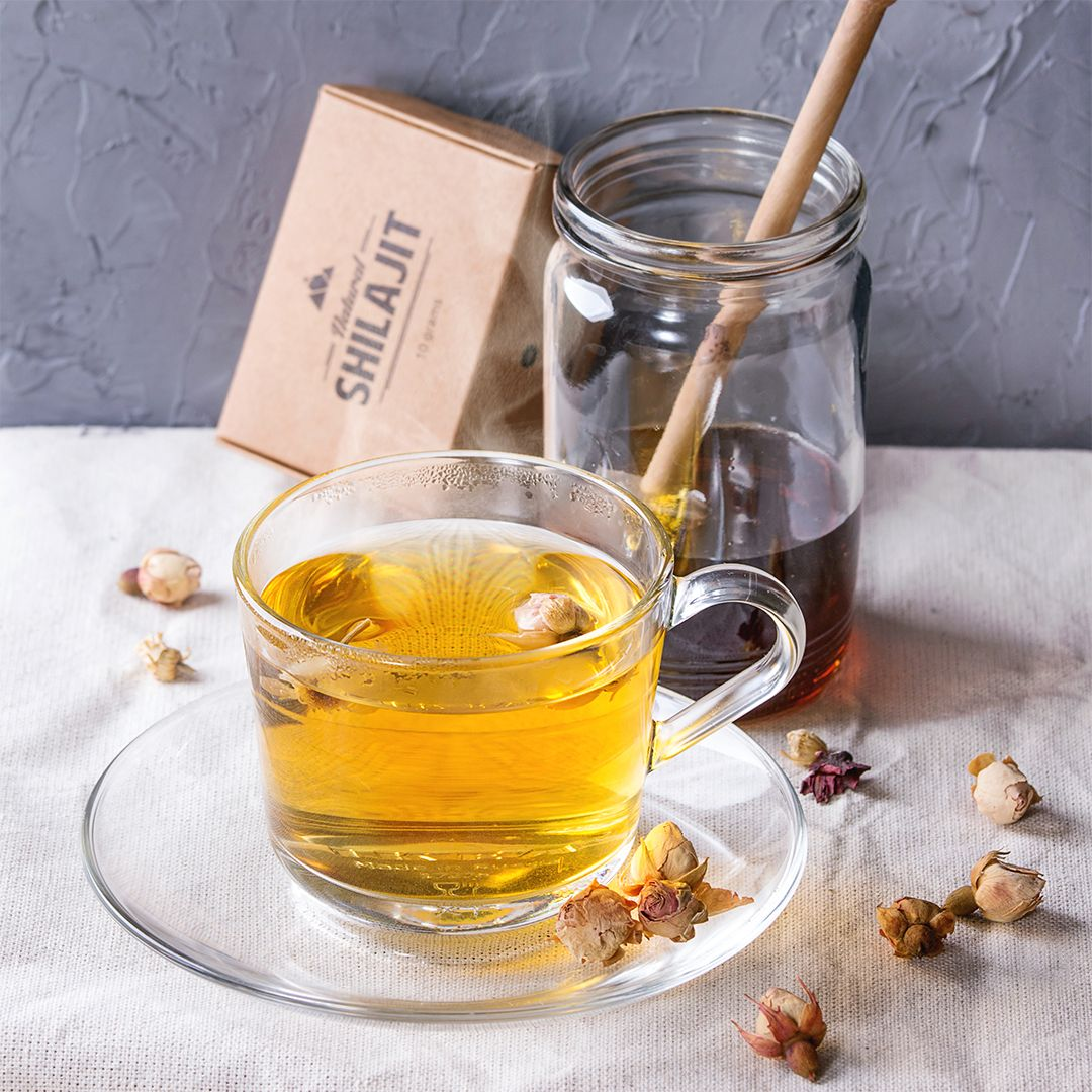 Herbal rooibos tea with dry rose buds honey and