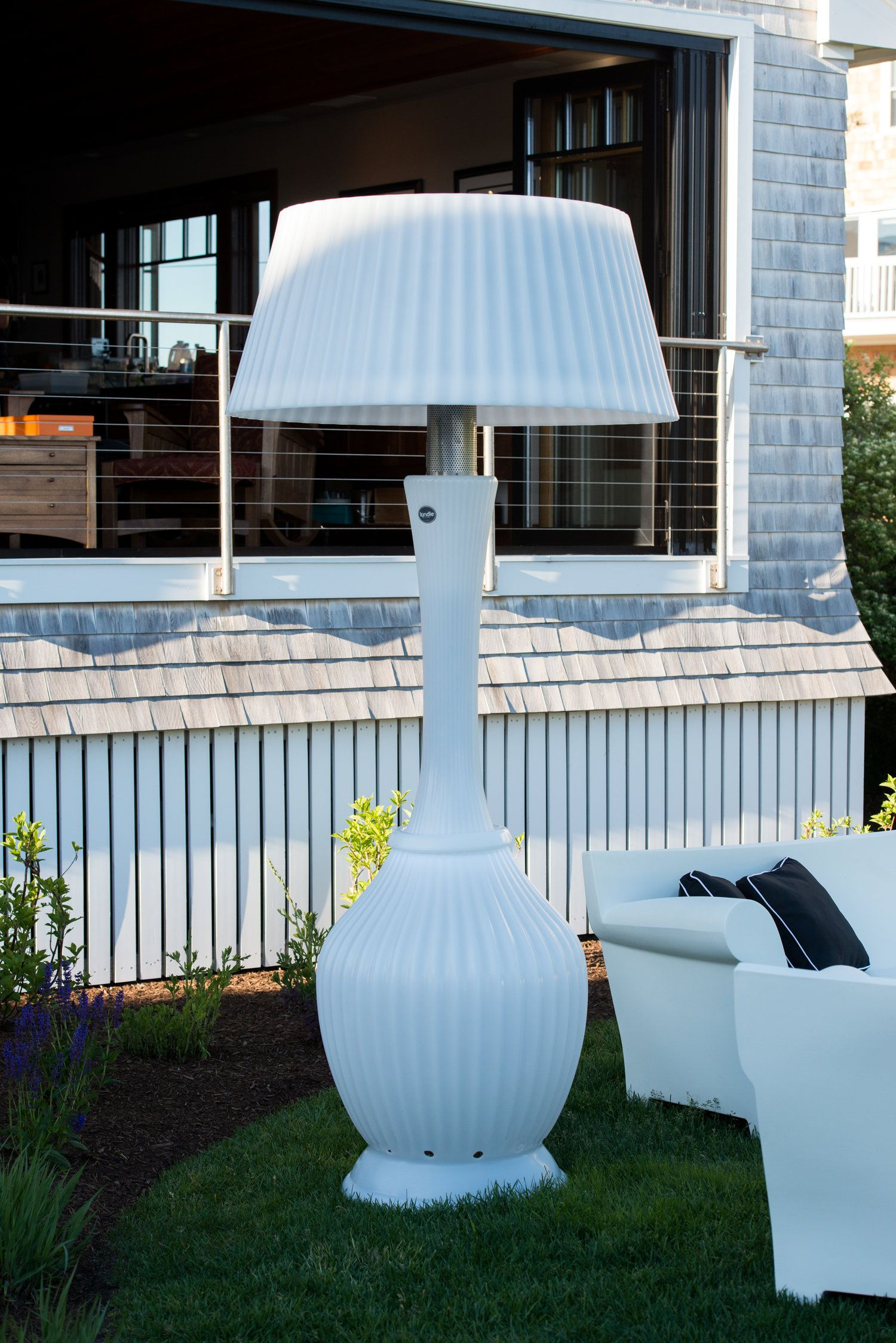 Kartell patio furniture and kindle living heat lamps at a dinner party on kennebunk beach for the annual kennebunkport festival