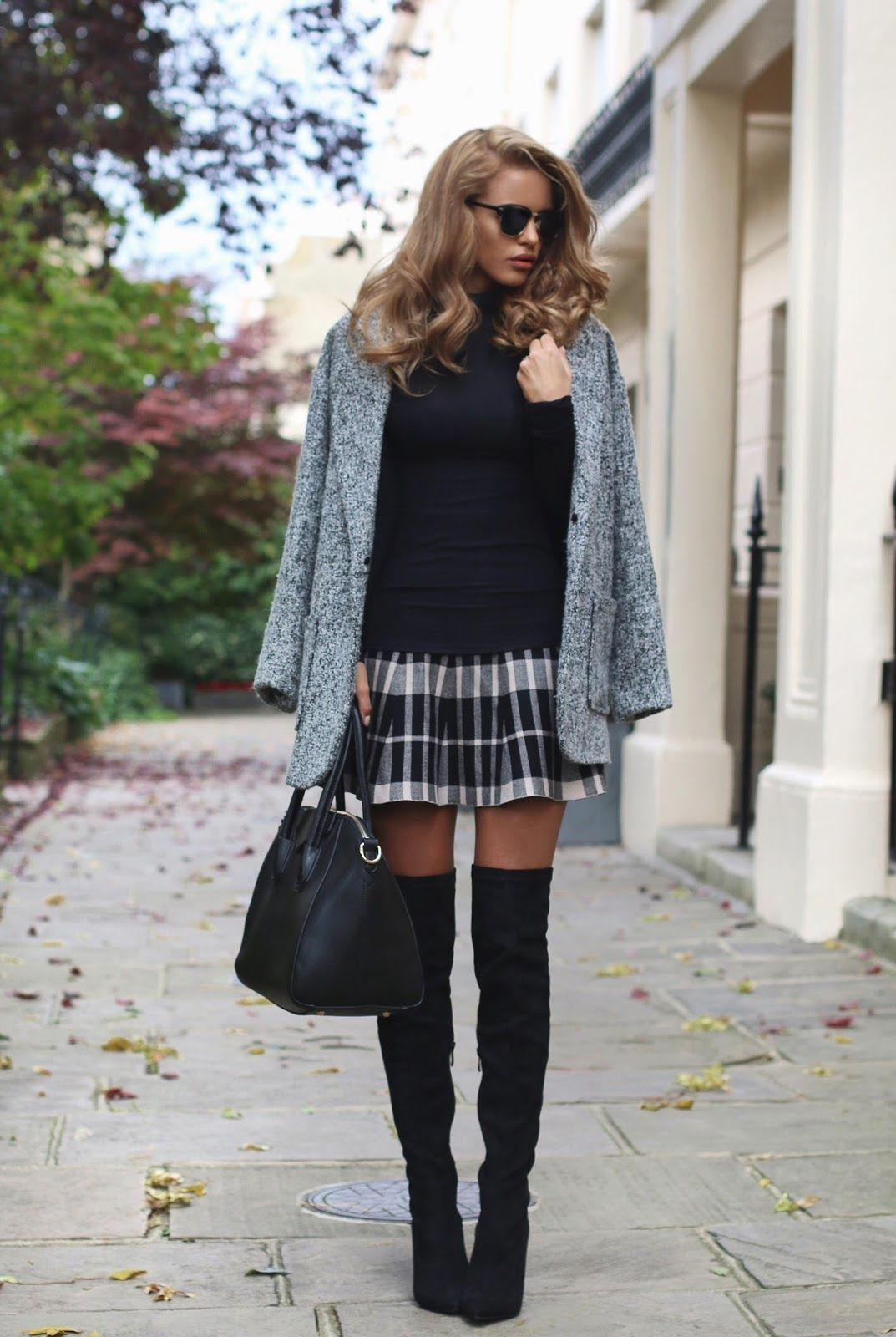 961758a27ca Nada Adelle wears patent over the knee boots with a cute tartan mini skirt  and a grey boyfriend coat. Coat  Glamorous