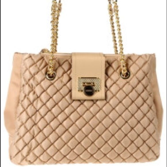 Lightly used Moschino handbag. Authentic. Beige Moschino handbag with gold chain straps. Quilted. Moschino Bags