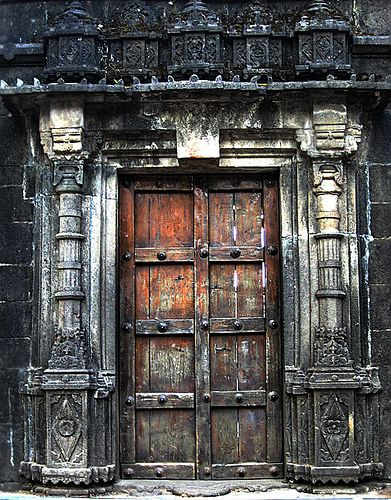 dark wood.. this door, and when you open, there are soaring windows,  tall ceilings, open spaces, clean lines.   nothing better than the surprise of a structures soul