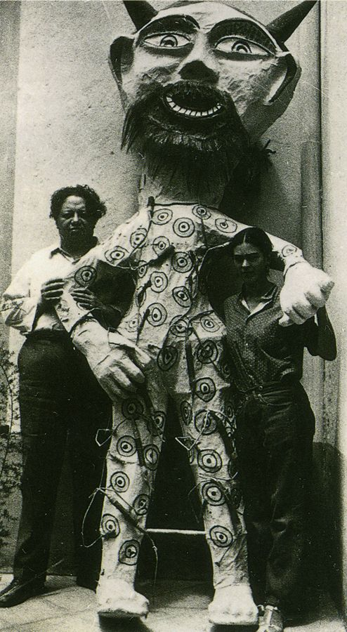 """Diego and Frida with a """"Judas"""" of their collection of these figures made by Pedro Linares.  The Burning of the Judases takes place annually on Holy Saturday, the day before Easter, and is generally celebrated with the explosion of papier-mâché Judas effigies. In the context of the festival, Judas not only refers to the apostle who betrayed Christ in the Bible, but also to evil and corruption in general. Source http://www.learner.org/courses/globalart/work/163/index.html"""