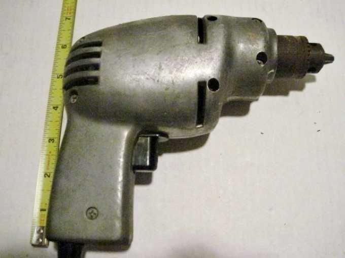 "Circa 1950's -Fury 1/4"" Electric Hand Drill Manufactured by Ram Tool Corporation, Chicago, ILL. USA Aluminum Case Drill - Model# F11-51269 - 2.0 amps - 115v No load RPM 2000. Original Metal Tag riveted to top of drill."