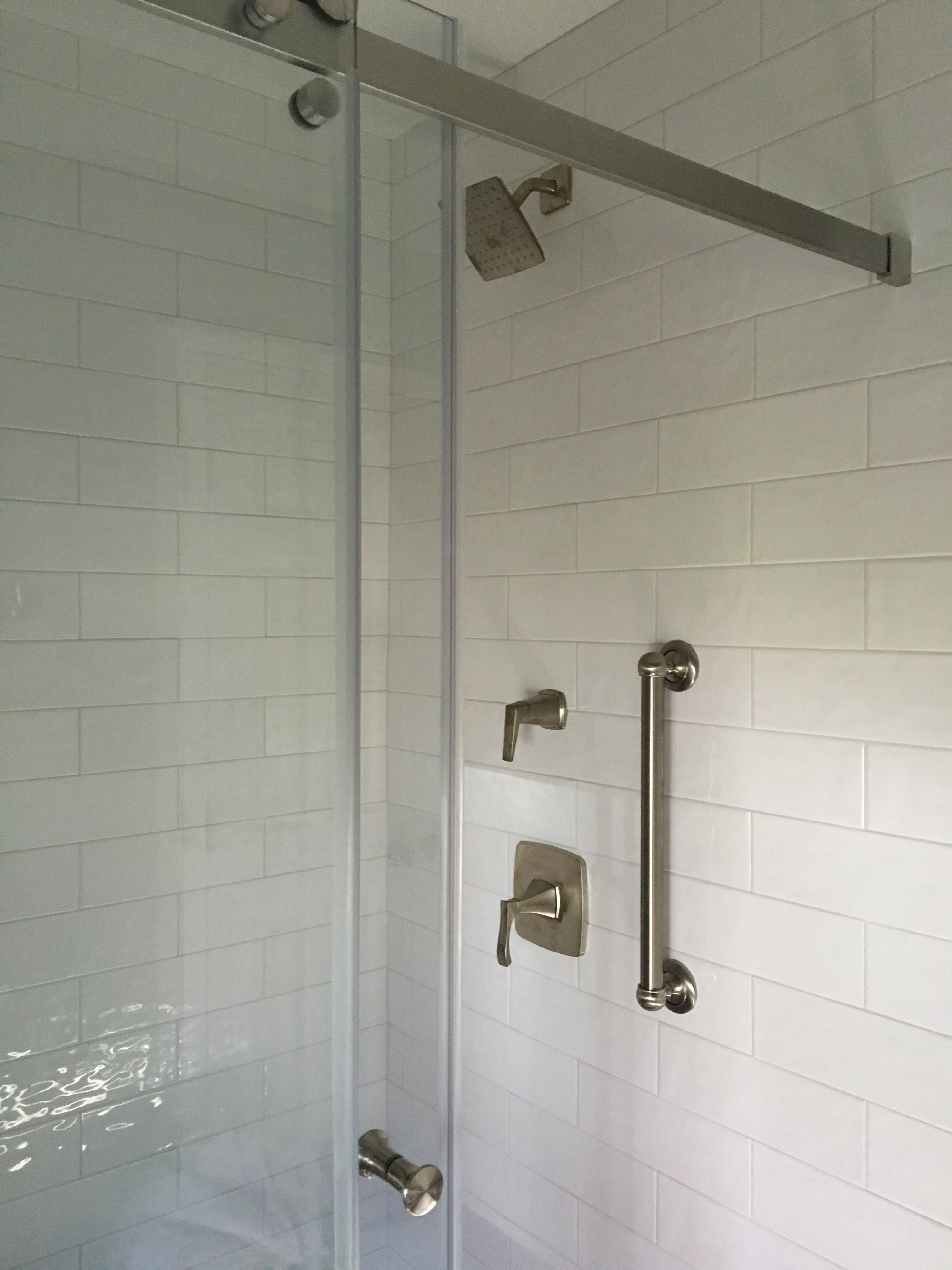White subway tile creates a clean look in this custom shower white subway tile creates a clean look in this custom shower installation dailygadgetfo Gallery
