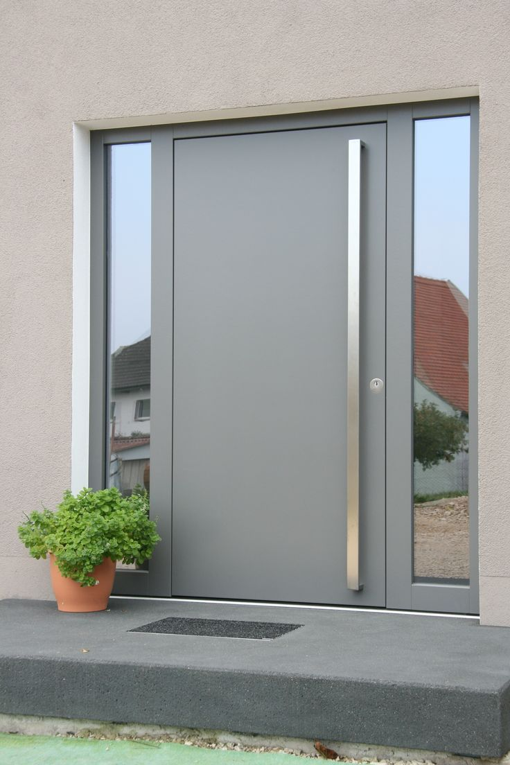 modern front door with glass side windows