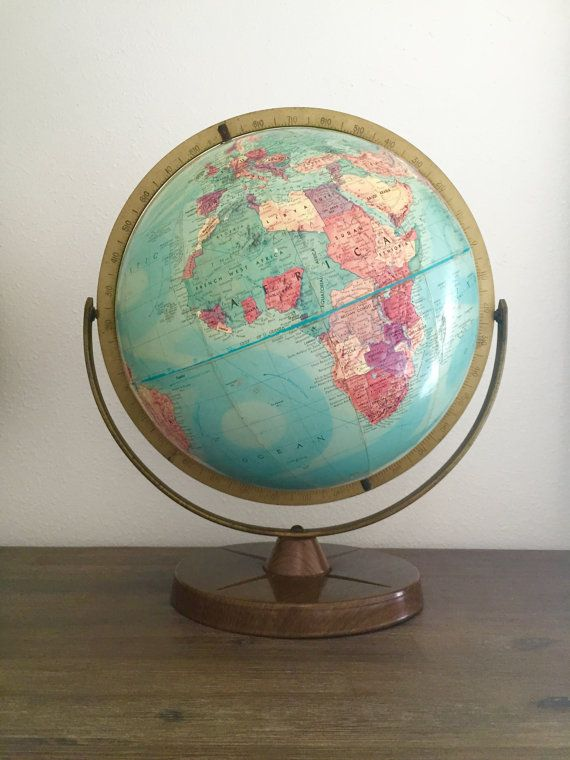 This vintage repogle 12 stereo relief globe dates to 1958 a blue this vintage repogle stereo relief globe dates to a blue globe ball with a brightly colored world map set on a wood style metal base with a metal time dial gumiabroncs Gallery