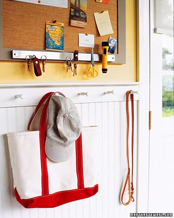 Attach a magnetic knife holder, available at kitchen-supply stores, along the bottom of an entryway bulletin board to keep important items -- keys, scissors, even an emergency flashlight -- within reach