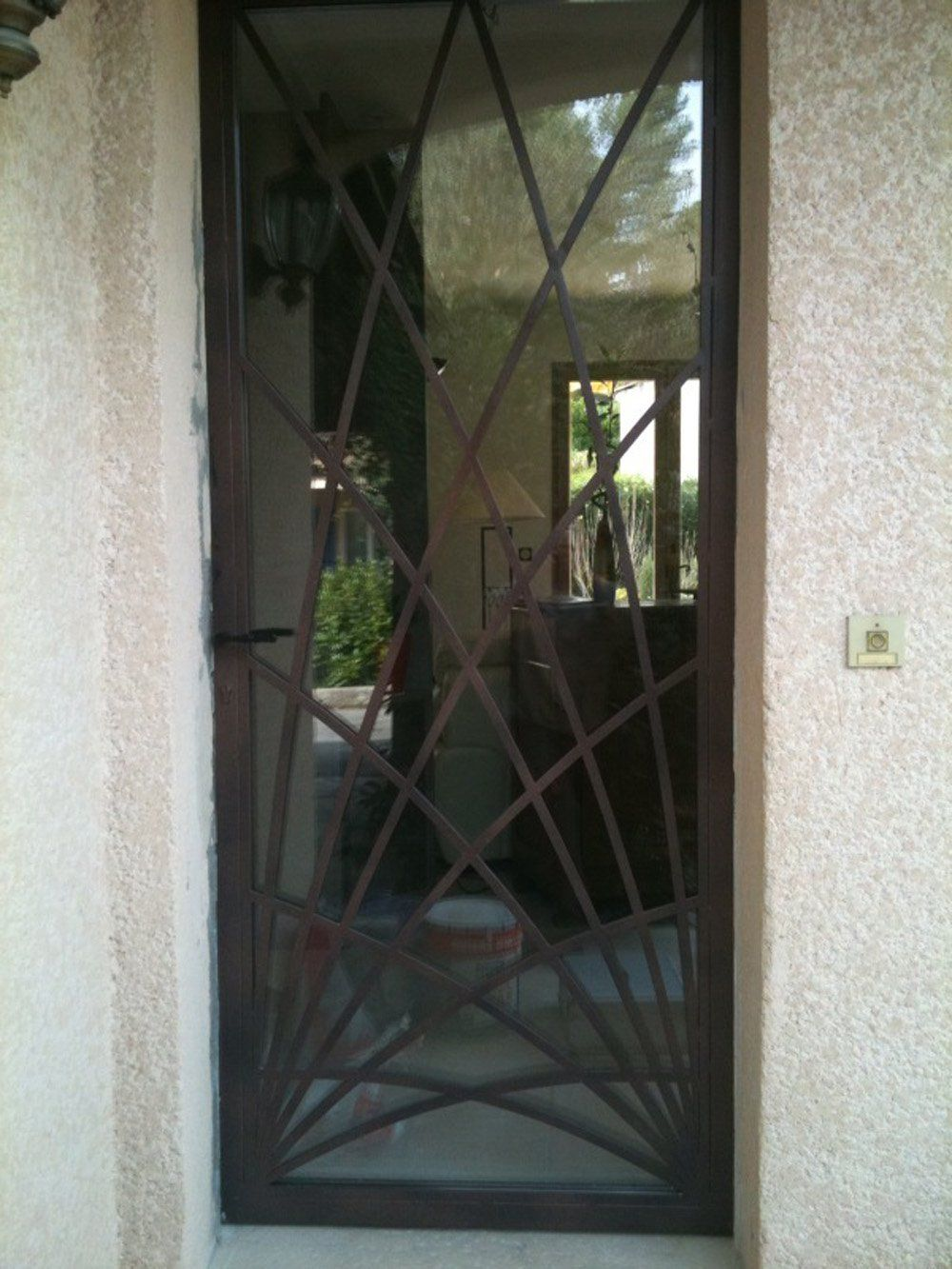 Nos mod les de grilles de portes et de fenetres en fer forg porte fer forge for Porte et fenetre en fer