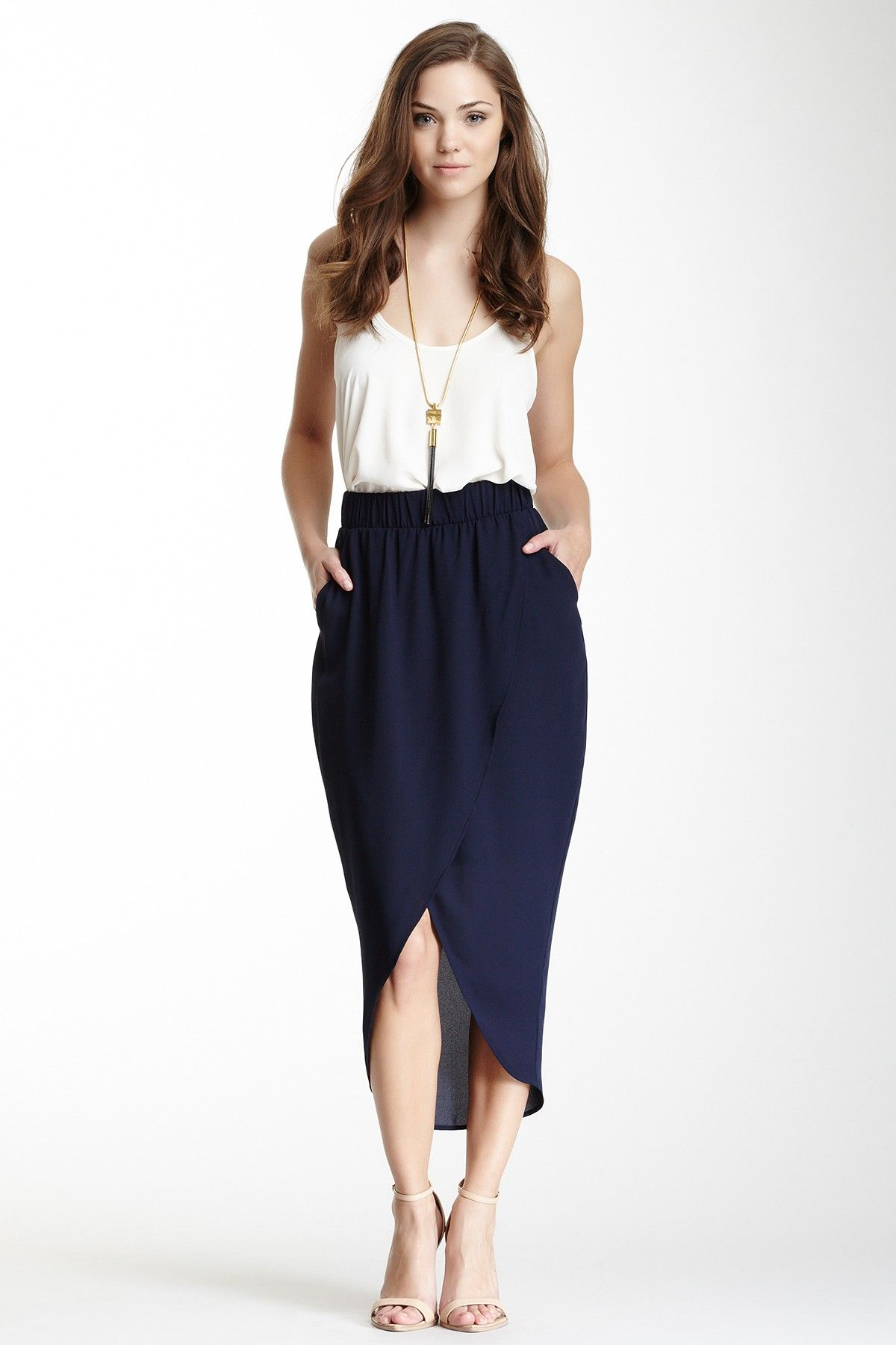 High waist long skirt with white top and long necklace is a ...