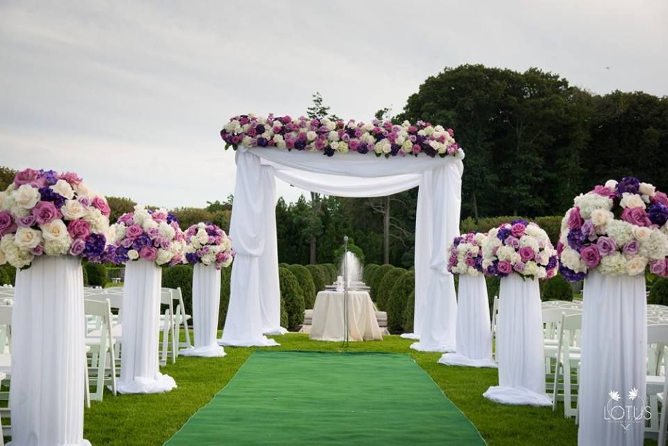 Wedding Ceremony Purple And Cream Wedding Bouquets On Pedestals