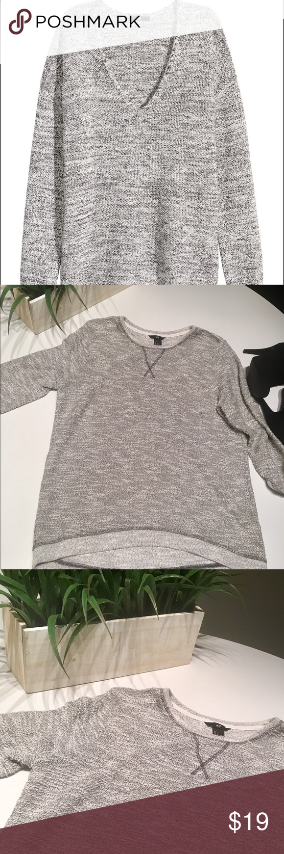 H&M tunic top Great gray and white sweater top! Dress up or dress down! Great condition. First picture is not exact. 69% Cotton 31% Polyester H&M Tops Tunics