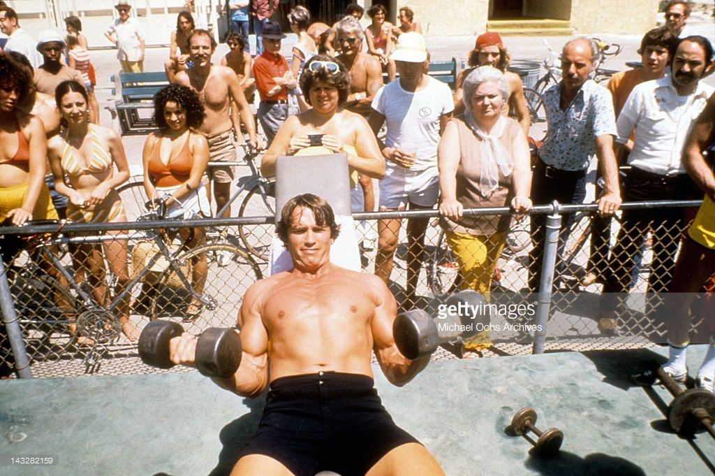 e71f06a2 Austrian Bodybuilder Arnold Schwarzenegger lifts weights at Muscle Beach in  Venice in August 1977 in Los