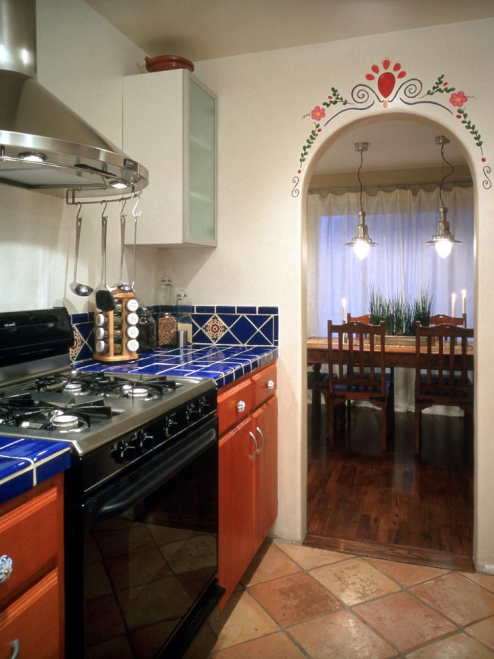 Handpainted Tiles And Archway Provide Authenticity For This Mexican Style  Kitchen. Design By Erica Islas