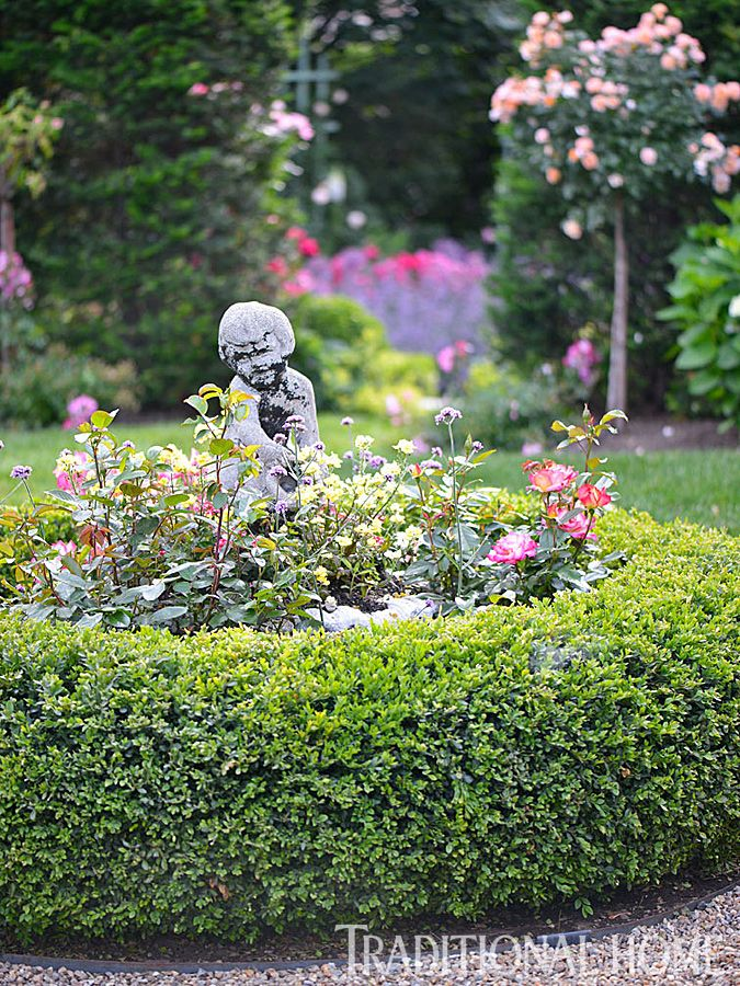 At the center of the Checkerboard Garden is a statue encircled by ...