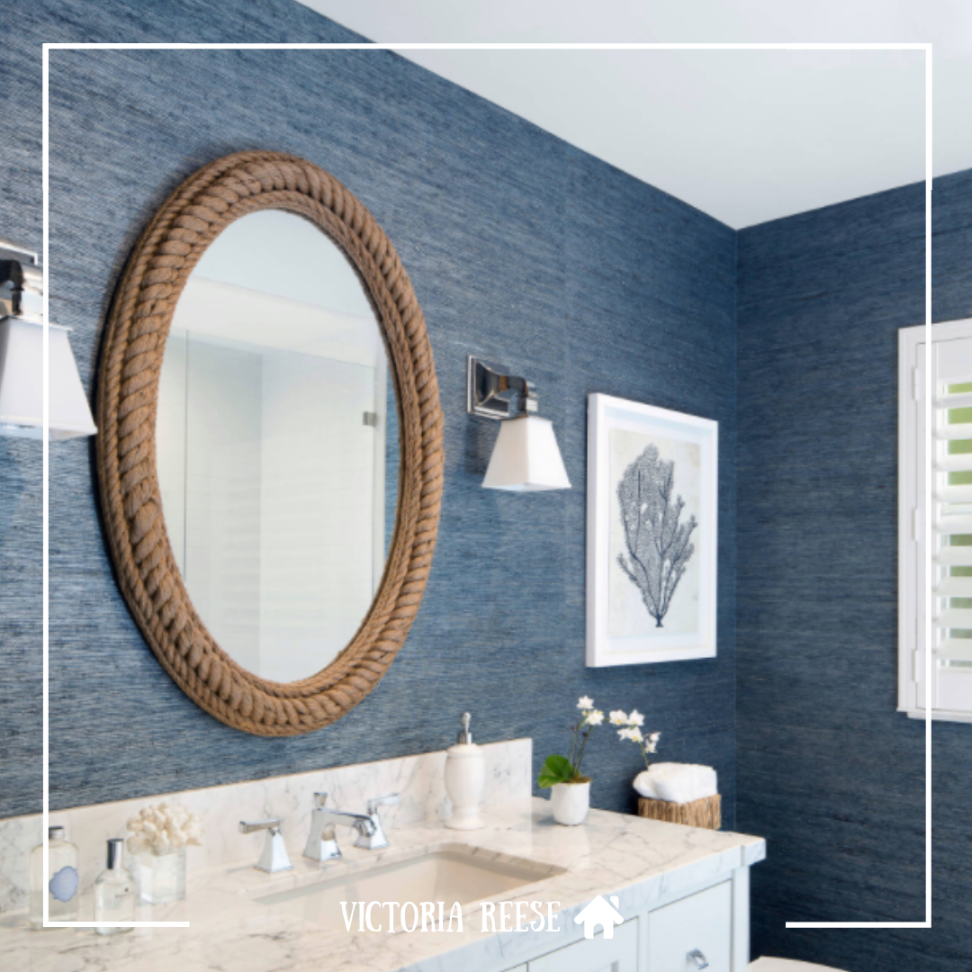 The textured blue grasscloth wallpaper and ropeframed
